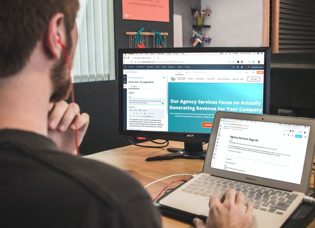 man looking at web design details on computer screen