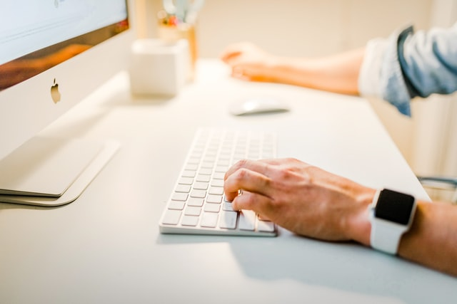 hands typing a content marketing proposal on keyboard