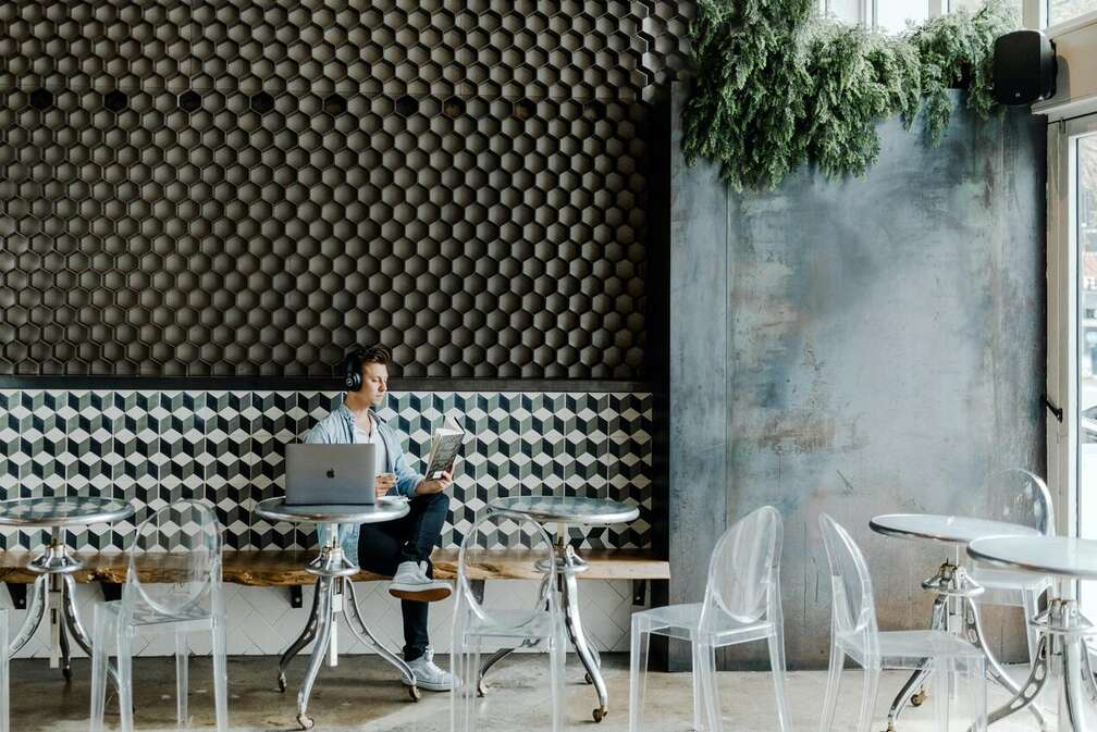 image of freelancer working at coffee shop alone