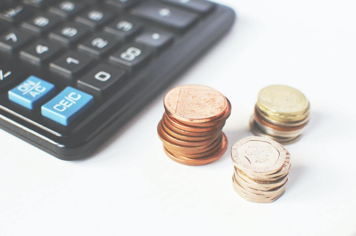 Close-up of coins signifying billable hours
