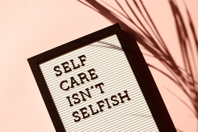A sign reading self care isn't selfish.