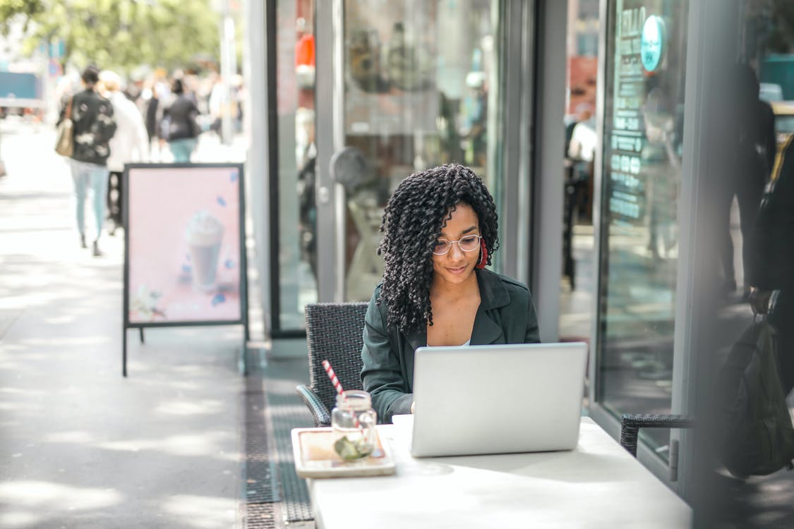 Woman working a freelance job from a cafe