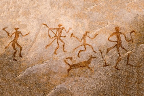 Caveman paintings illustrating interaction between human and canine