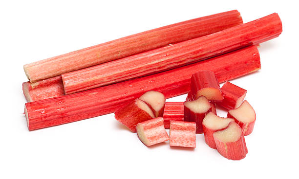 cut rhubarb sticks cut rhubarb sticks isolated on white background rhubarb stock pictures, royalty-free photos & images