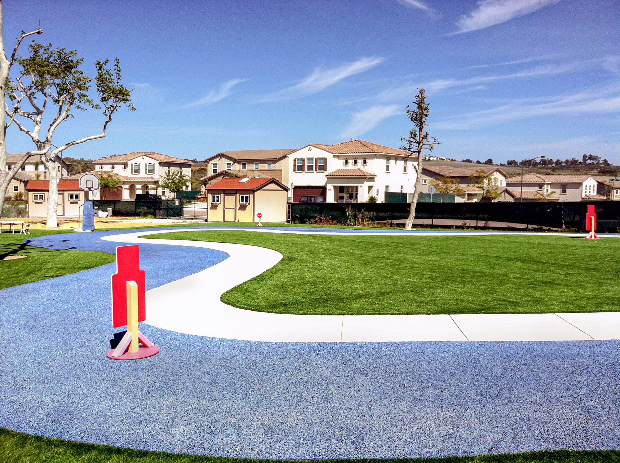 Residential kids park with artificial turf and rubber surfacing