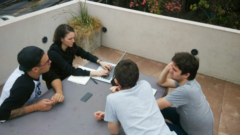 Team meeting at a table outside