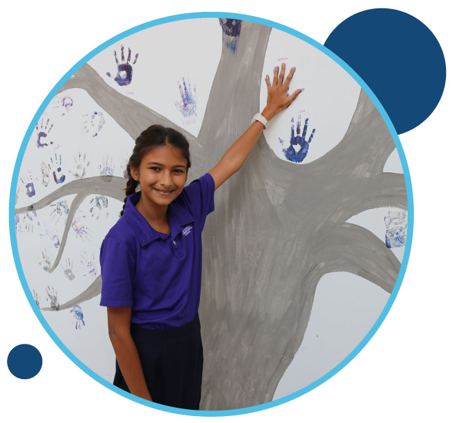 Student leaving hand print on wall