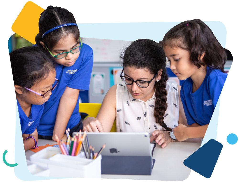 Four-students-huddled-around-apple-laptop