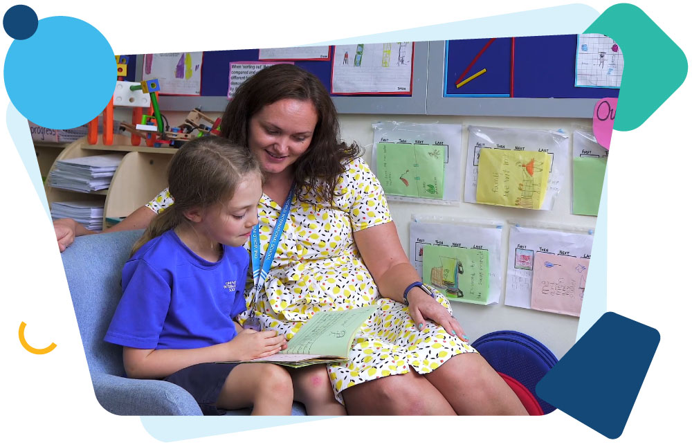 teacher-reading-with-student