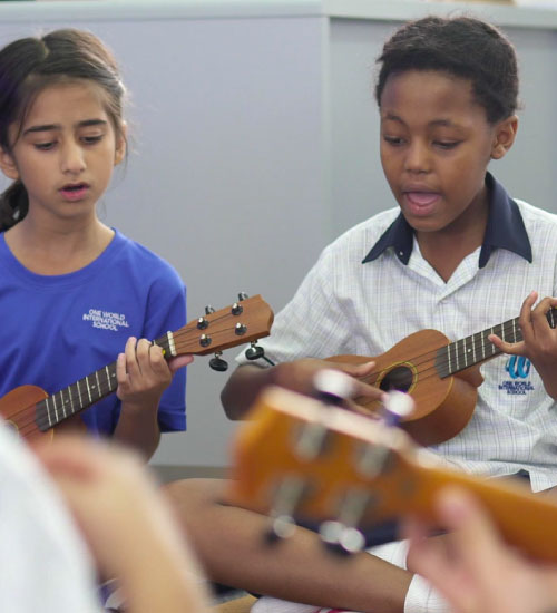 two-students-playing-instrument