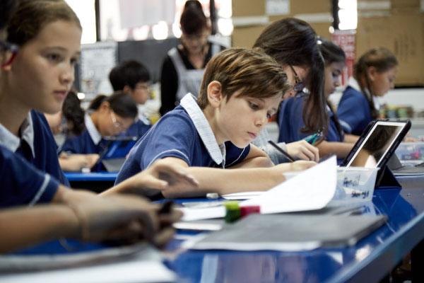 students-doing-classwork-in-classroom