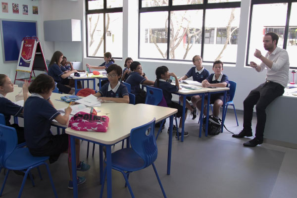 classroom-of-students-with-teacher-at-front-of-class
