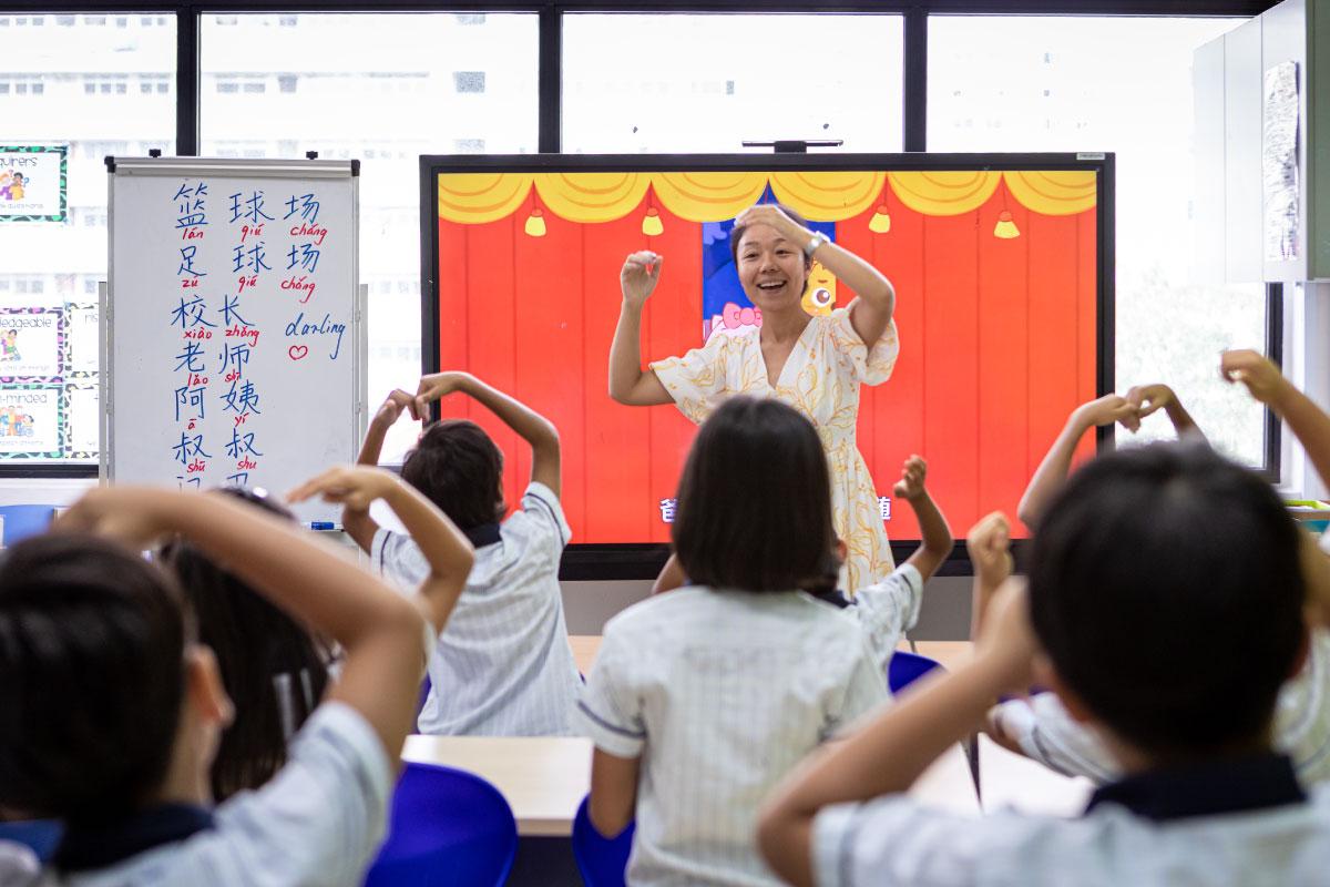 children-interacting-with-teacher
