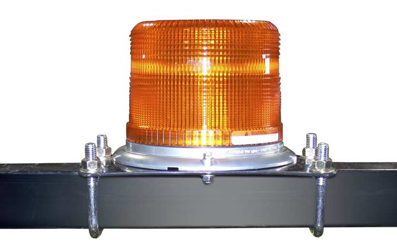Image of an orange light mounted on a black roll over bar of a mower.