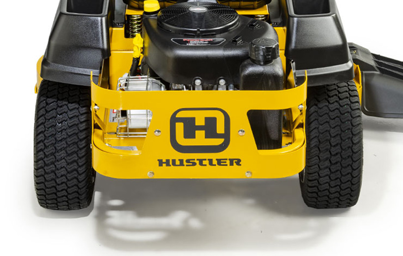 Image of the rear metal guard around the engine of a yellow mower