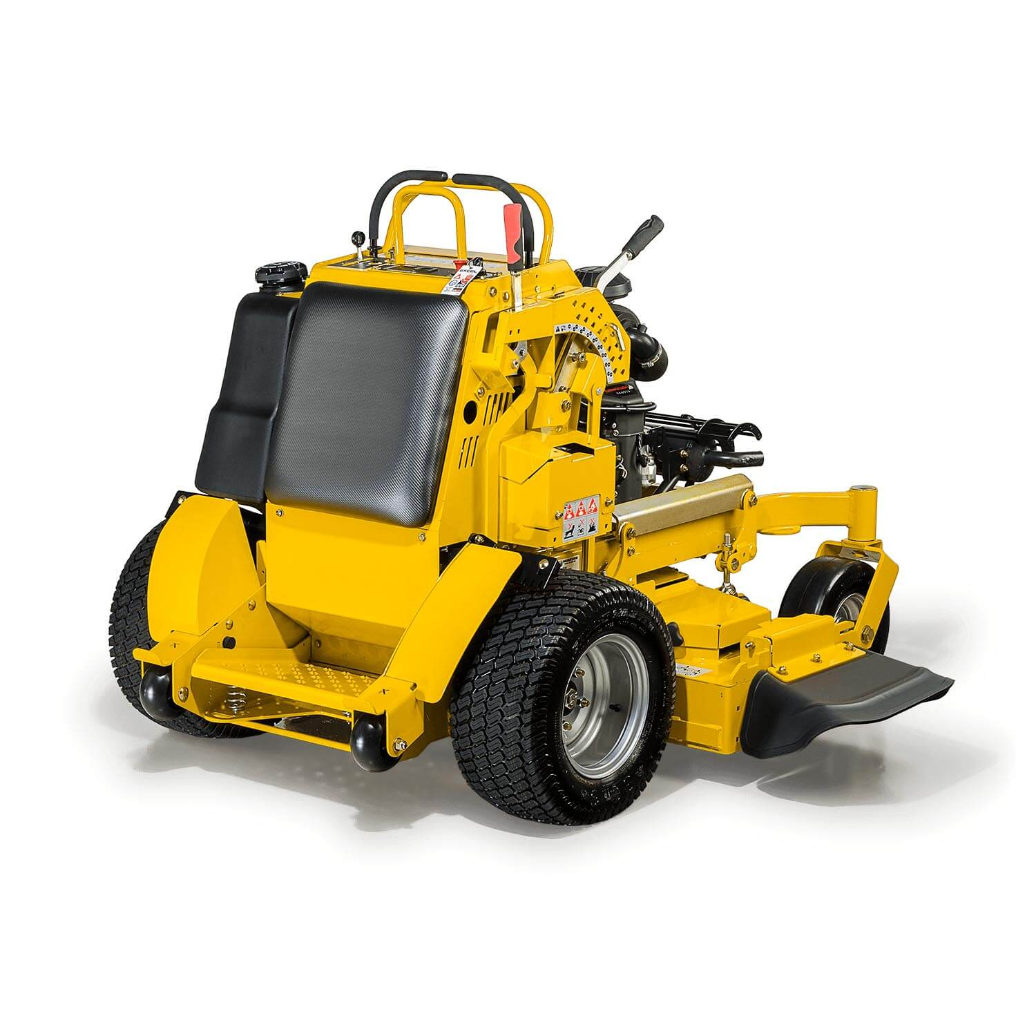 Image of the rear three quarters of a yellow stand-on mower showing the discharge chute of the deck