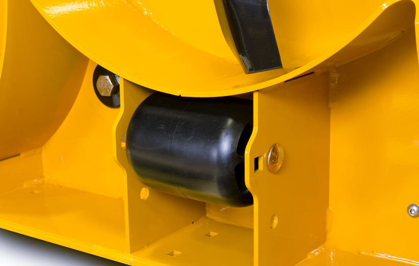 Image of the underside of a yellow mower deck with a black wheel mounted between plates of steel