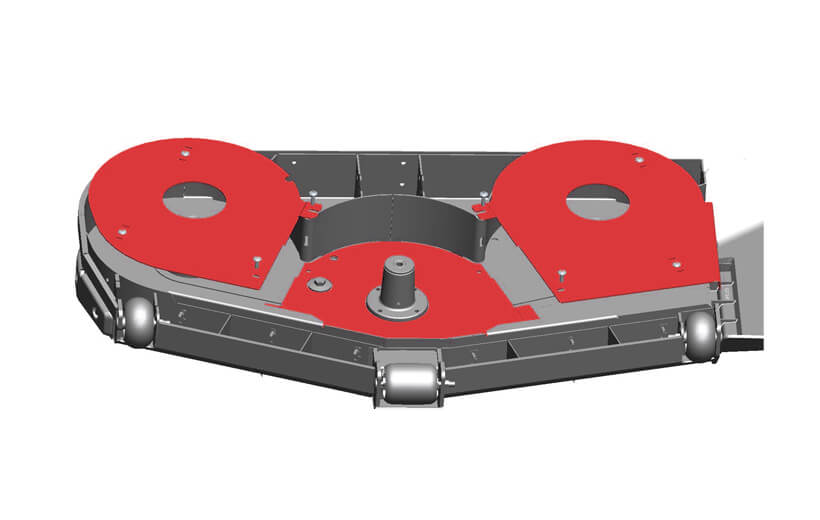 Image of the underside of a mower deck with the sand kit shown in red mounted under the deck spindles.