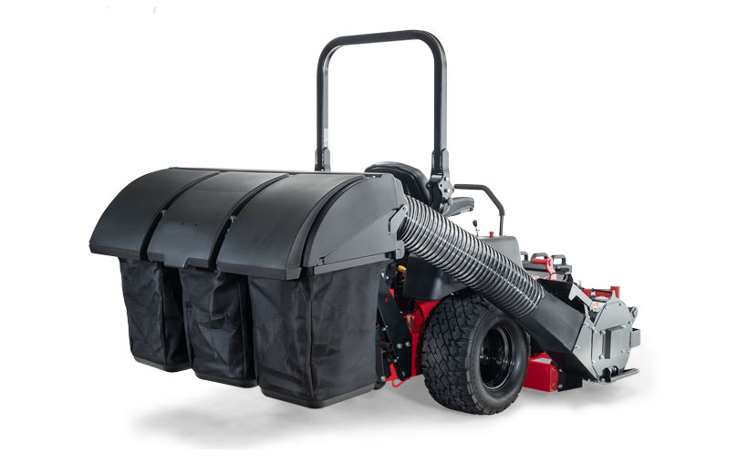 Image of the back of a mower with a black 3 bag catcher mounted to the back.