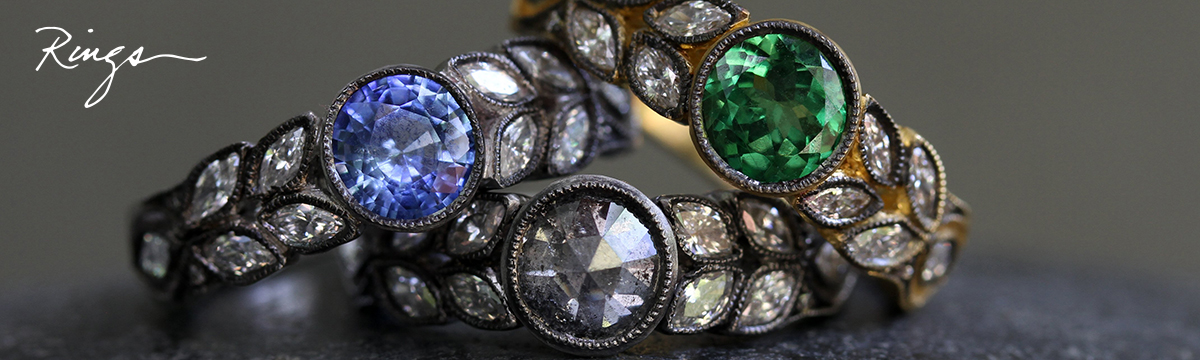 """Photo of three Cathy Waterman rings with handwritten title that reads, """"Rings."""""""