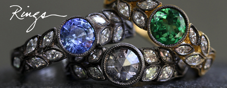 """Photo of three Cathy Waterman Rings with handwritten title that reads, """"Rings""""."""