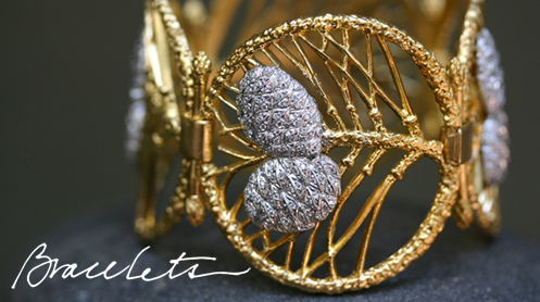 "Photo of Cathy Waterman pine cone bracelet with handwritten text that reads, ""Bracelets""."