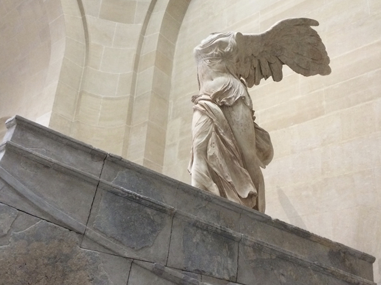 Photo of the Winged Victory of Samothrace in the Louvre.