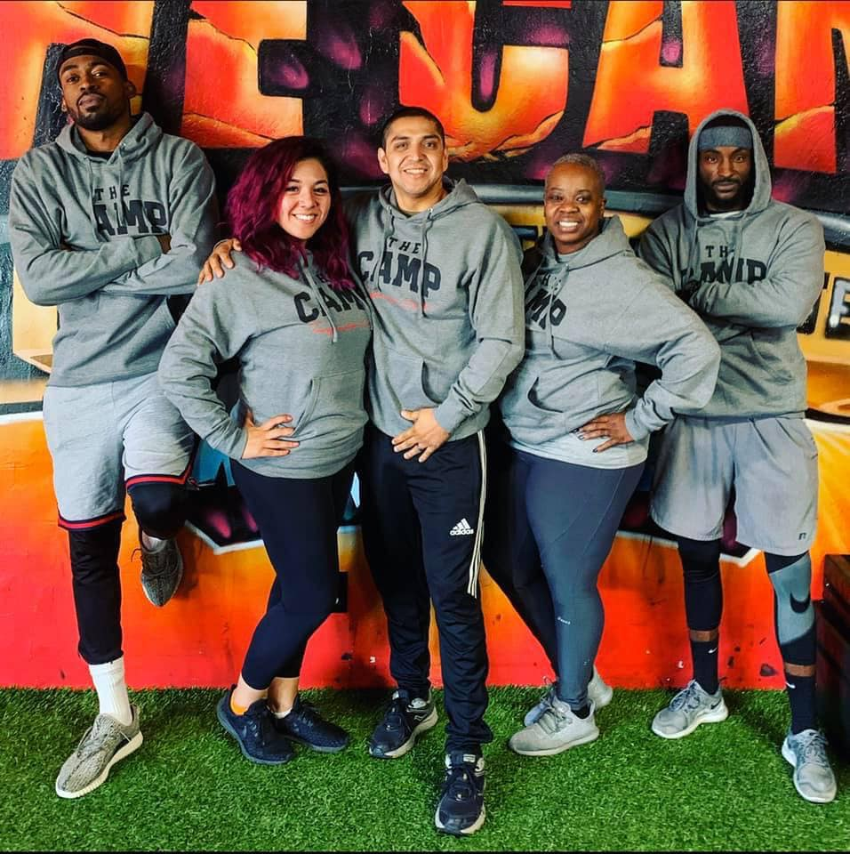 The Camp staff in matching hoodies