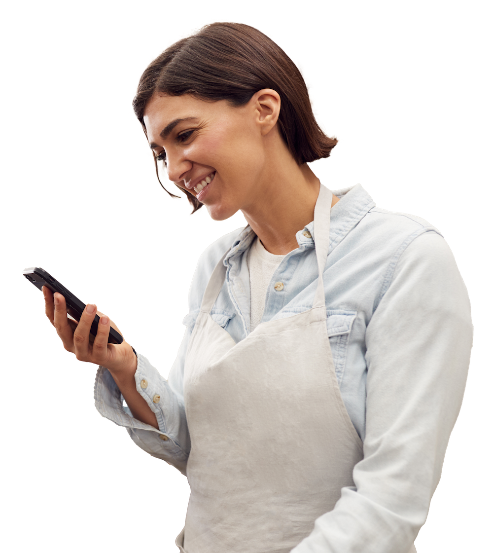 frontline worker wearing apron looking at coaching message on smartphone