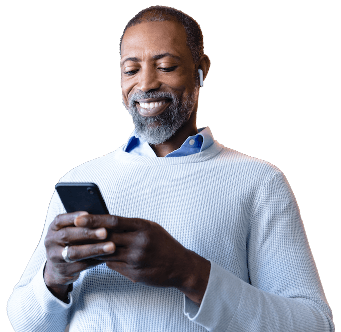 businessman checking phone and smiling