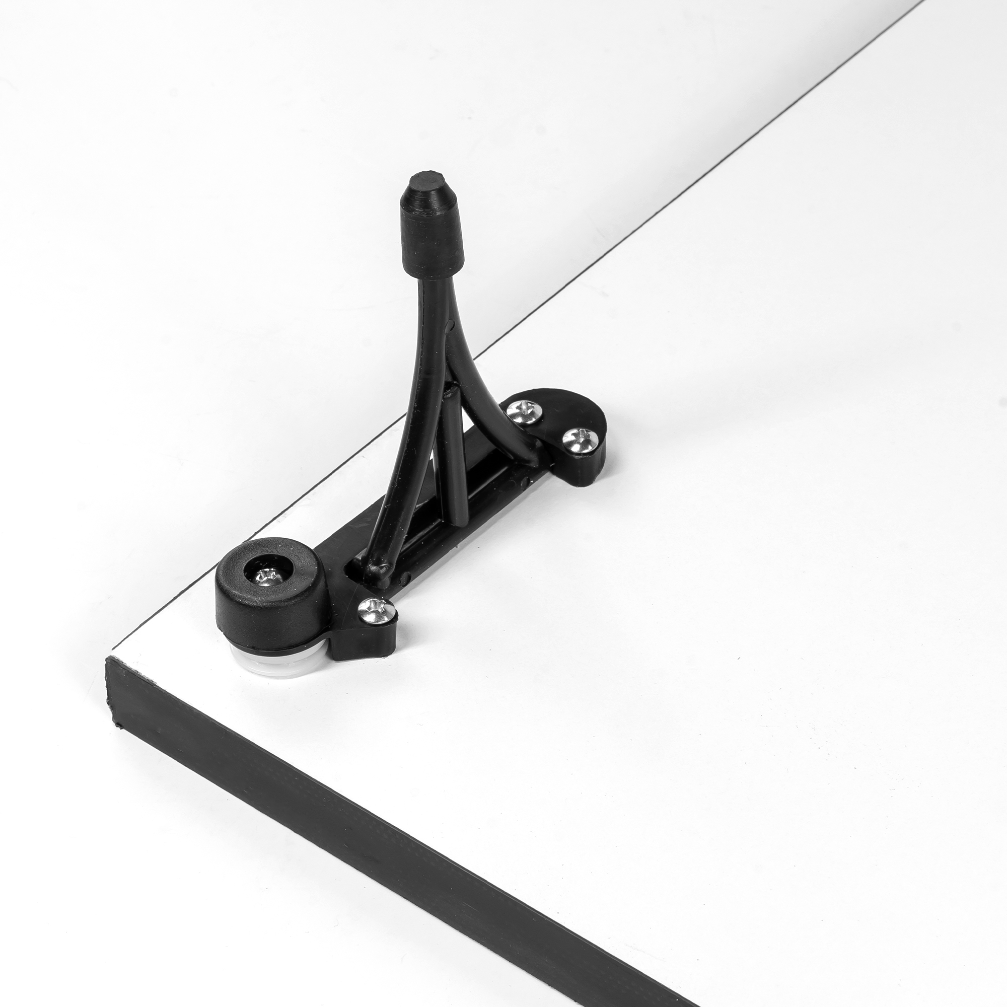the stp drafting drawing board by pacific arc with legs that bend upright with rubberized shoes to protect your surface and keep it in place.