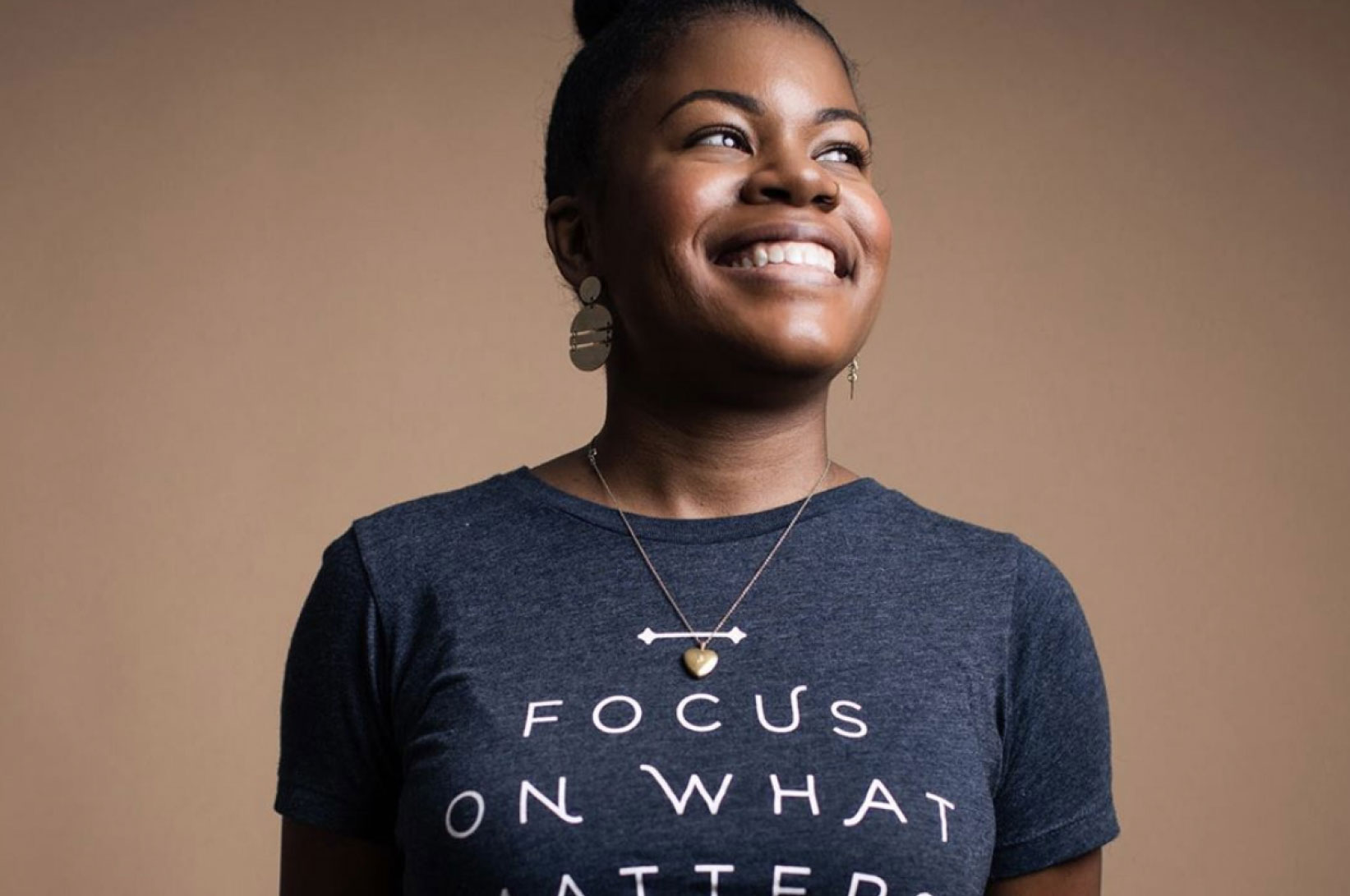 Photographer, Chanel French smiling with a Focus On What Matters Most shirt