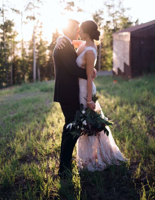 Wedding portrait of bride and groom embracing by the Scobey's