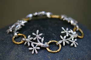 22K Recycled Gold and Platinum Bouquet Bracelet with Ethically Sourced Diamonds, flower, branch, flex, link, mixed metal, nature, organic, bouquet, petal, daisy