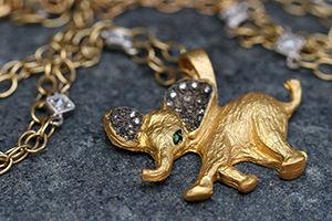 22K Recycled Gold Happy Baby Elephant Charm with Ethically Sourced Emerald and Diamonds on 22K Gold Black and White Diamond Square Bezel Chain, pendant, animal, yellow, colored stone, mixed metal, colored