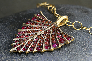 22K Recycled Gold Shield Pendant with Ethically Sourced Rubies and Orange Sapphires on 22K Gold Lacy Chain, yellow, colored stone, charm, colored, fin, tail, fan