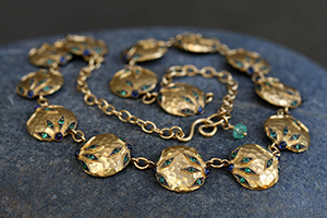 22K Recycled Gold Flower Overlay Chain of Hammered Charms with Ethically Sourced Emeralds and Sapphires, yellow, necklace, colored stone, leaf, leaves, blackened, choker
