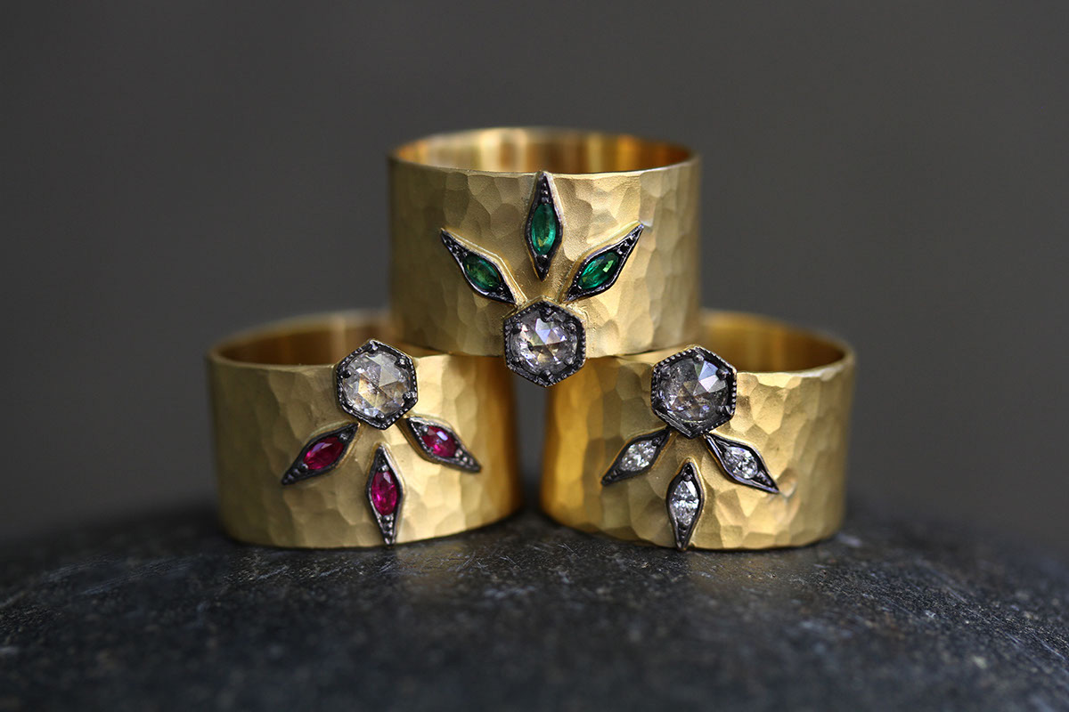 22K Recycled Gold Hammered 3 Leaf Cigar Band with Ethically Sourced Rubies and Black and White Diamond, 22K Recycled Gold Hammered 3 Leaf Cigar Band with Ethically Sourced Emeralds and Black and White Diamond, 22K Recycled Gold Hammered 3 Leaf Cigar Band with Ethically Sourced Black and White Rustic Diamonds, yellow, colored stone, leaves, colored