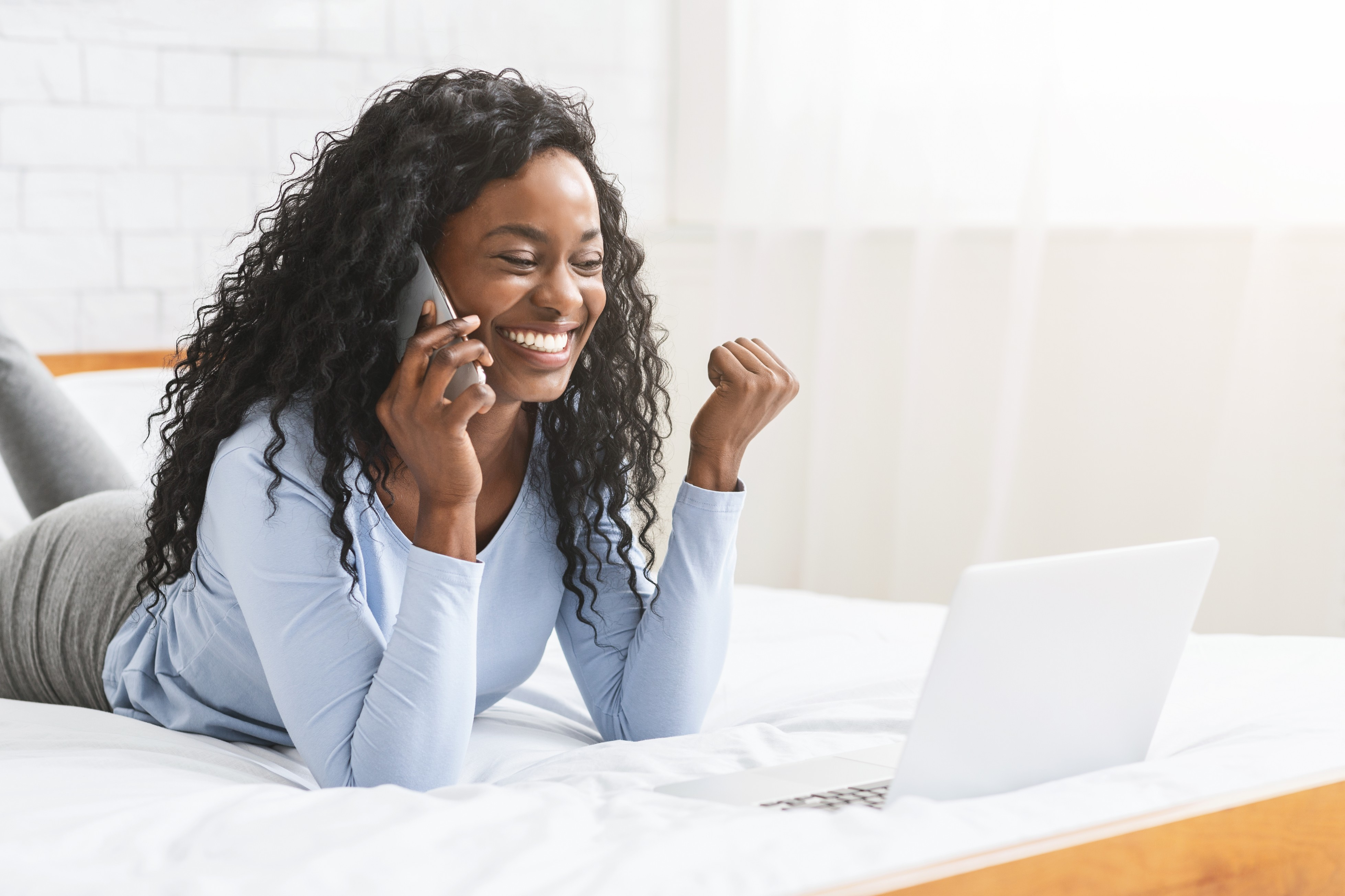 Excited young women got job talking by phone