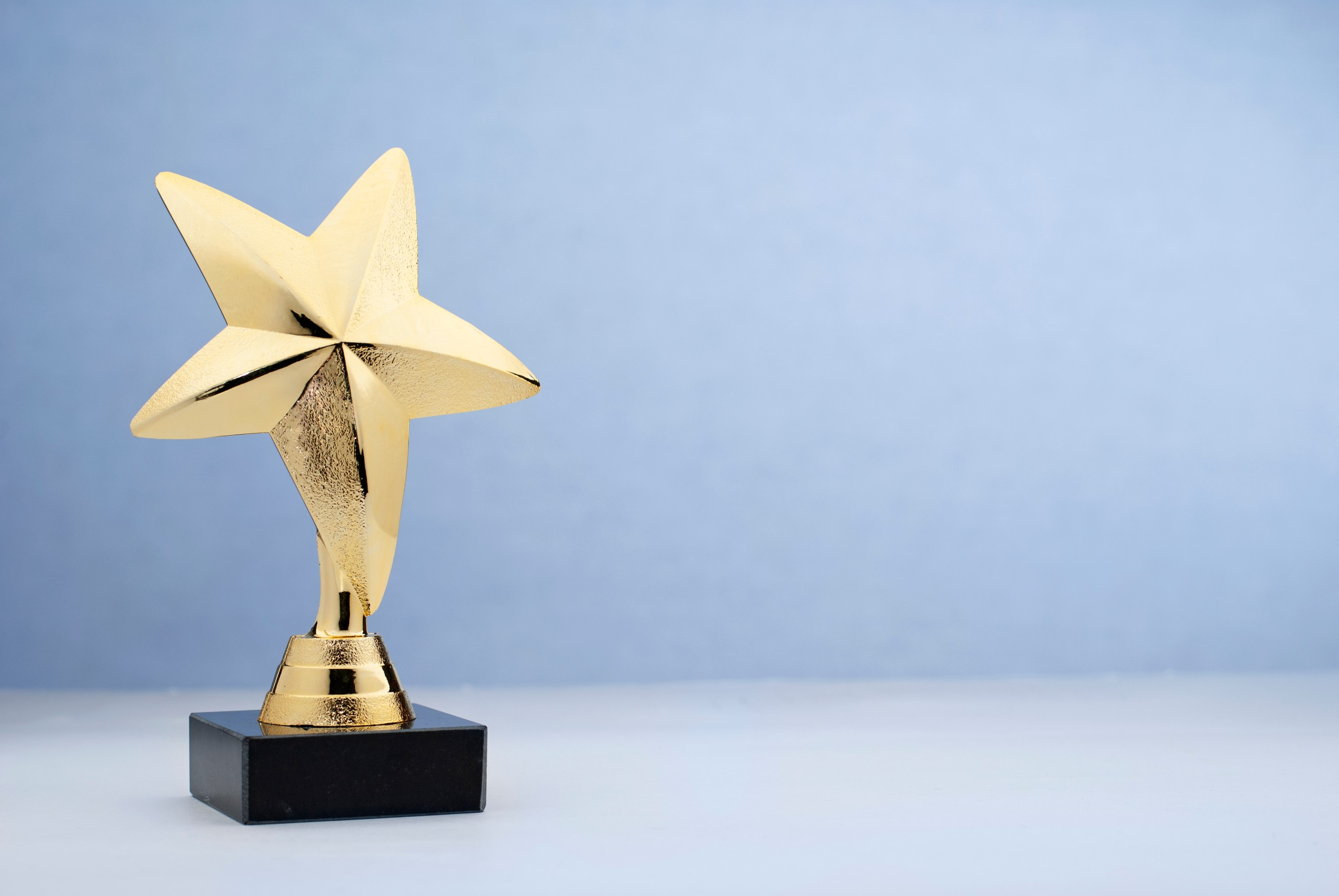 Star shaped golden trophy for rewarding