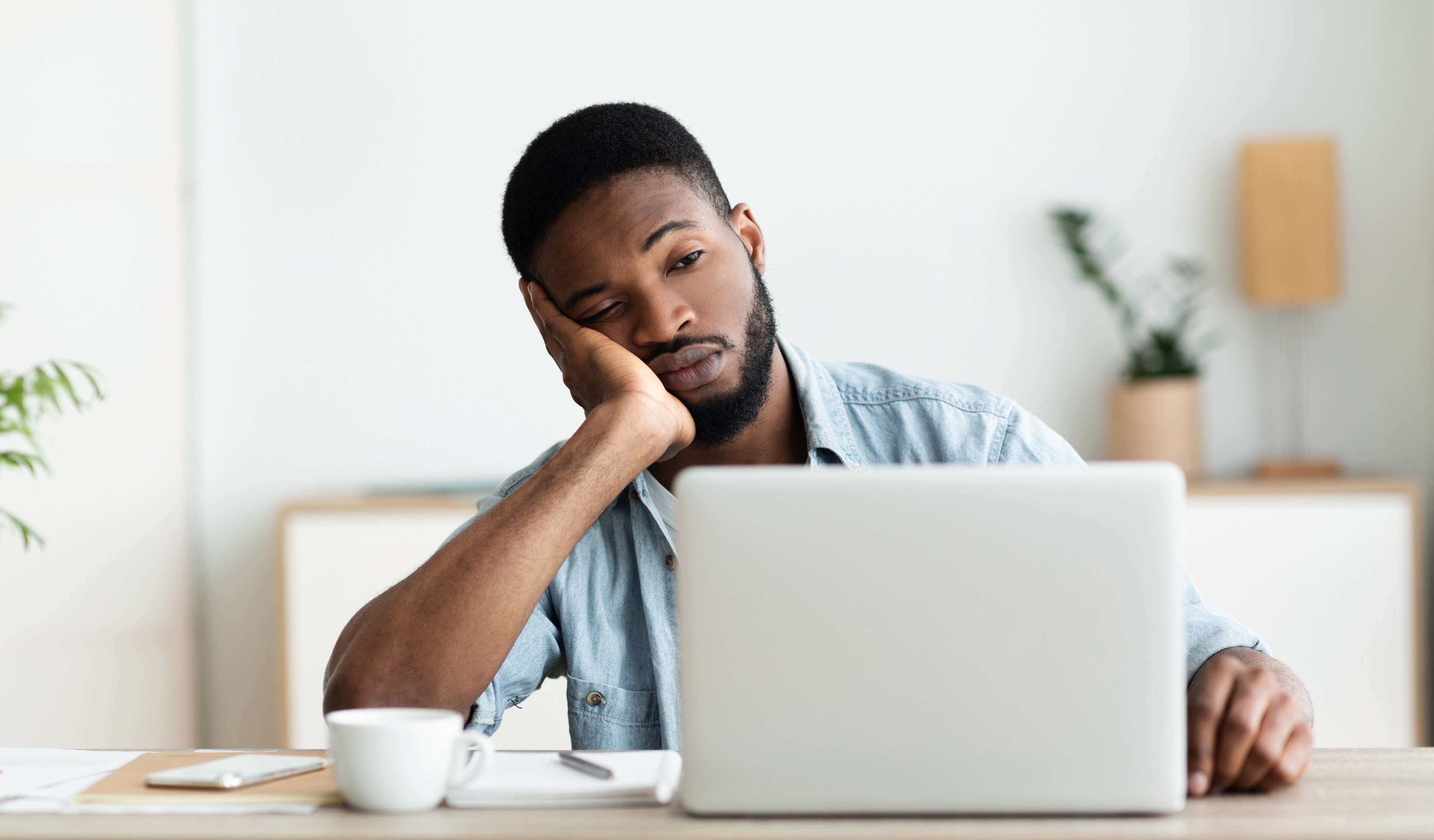 bored employee sitting in office