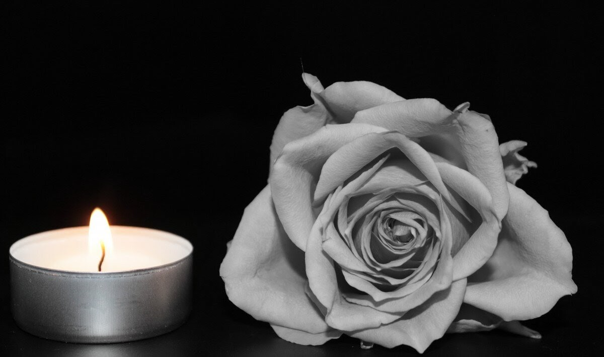 Dark imagery and mourning: flower and candle