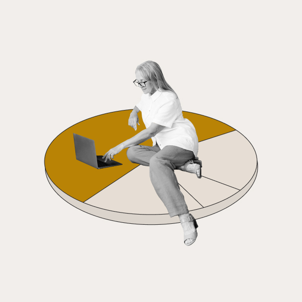 woman sitting on pie chart with laptop