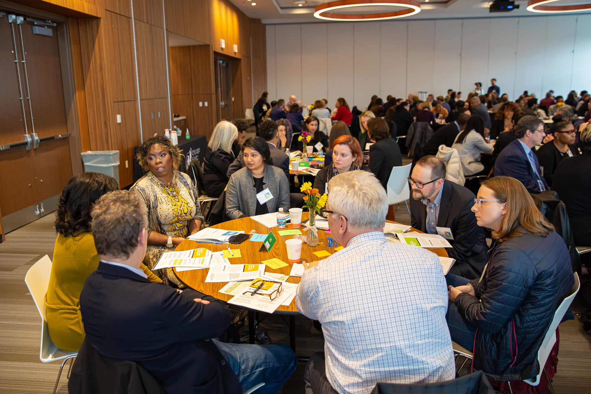 People sitting around table at a conference