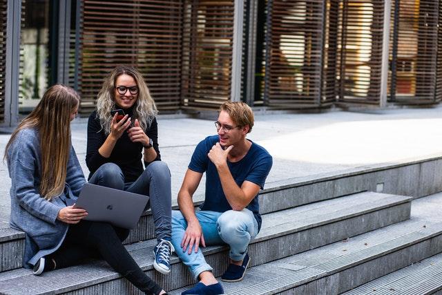 millennial homeowners talking outside