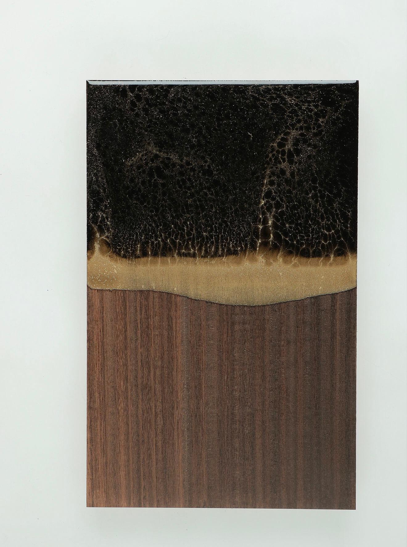 WUNDAA™ Nero Portoro su legno