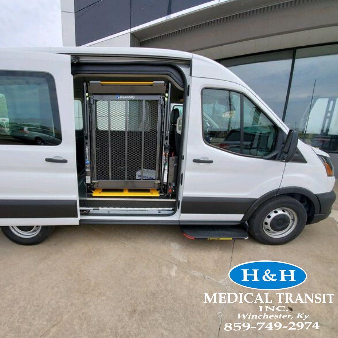 H&H van with side door open, displaying electronic wheelchair lift.