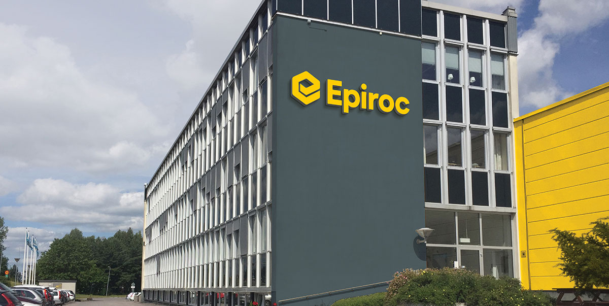 The yellow Eprico logo on the side of a grey building.