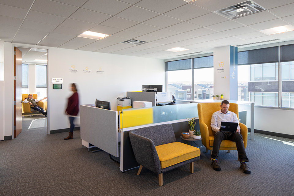 employees working in small gathering spaces