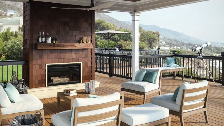 Deckorators deck with ample seating and a fireplace.